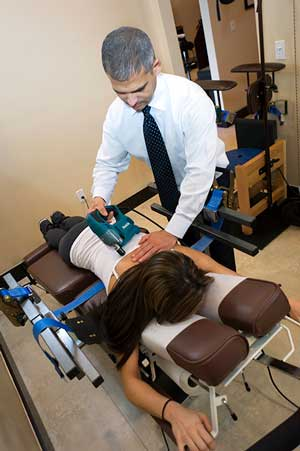 Corrective Chiropractic Care - Flexion Distraction Table with Core Simulation